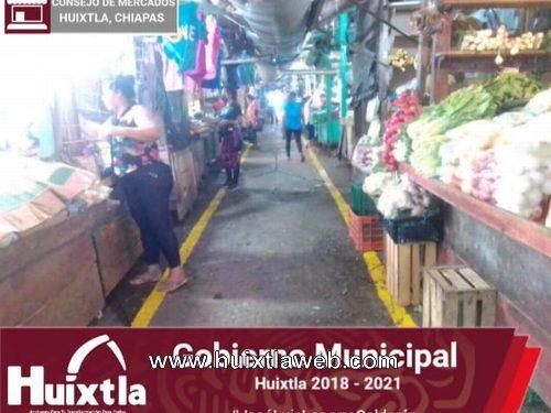 Pintan señalización de límites de puestos en el mercado Miguel Hidalgo